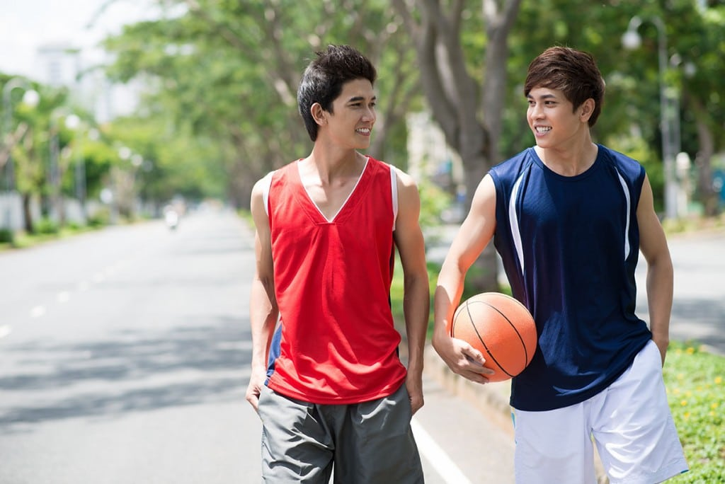 Christian boarding school student talking and walking with friend