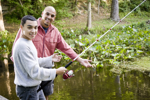 Fishing wilderness therapy with young teen and older man