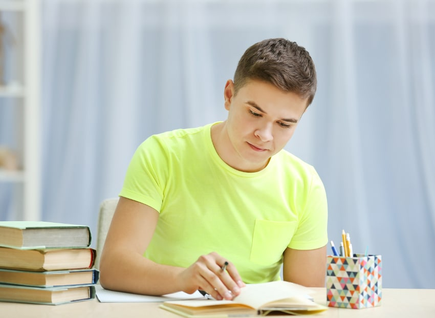 teen studying at boarding school with rehab treatment