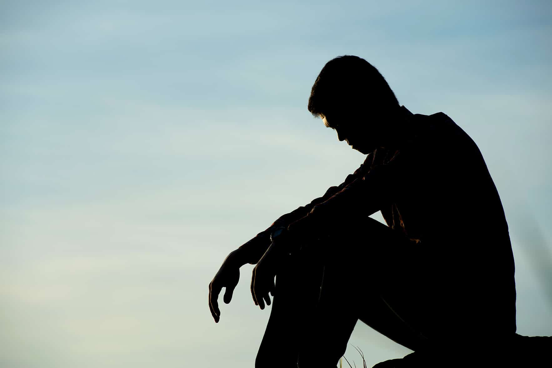 Silhouette of a young man in need of programs for troubled teens