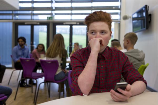 Teenage boy at school going through teen rehab