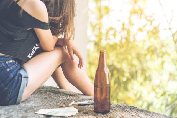 Teenage girl drinking drug treatment